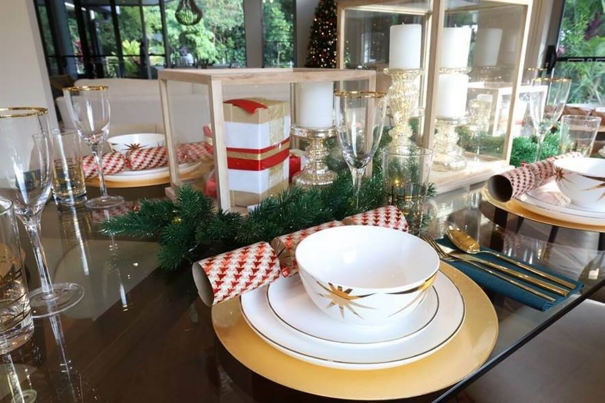 A festive table with touches of greenery brings the outdoors in
